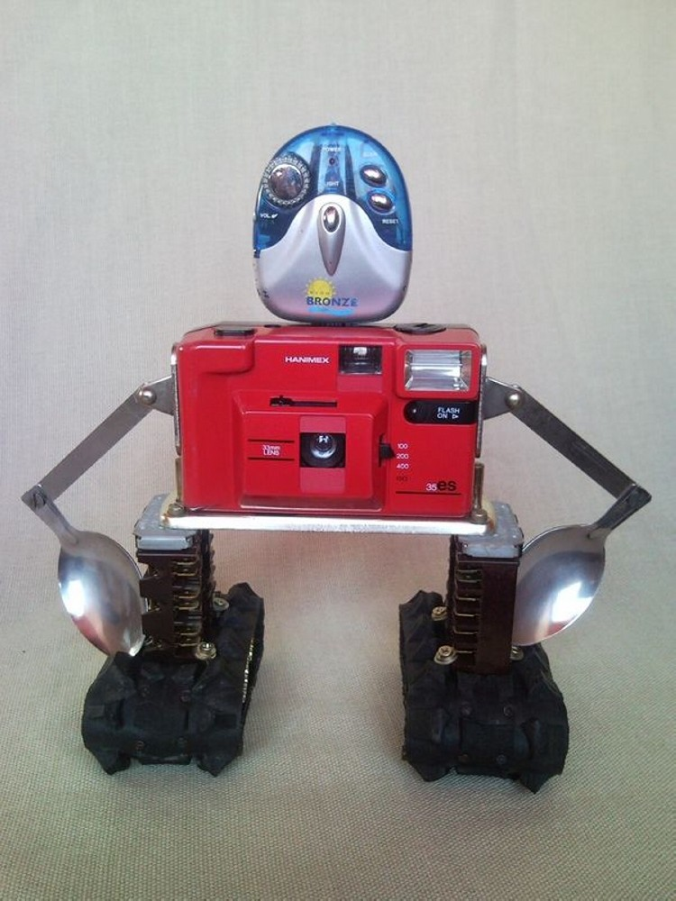 Recycled robot from photo camera