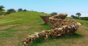 Cordwood fence sculpture