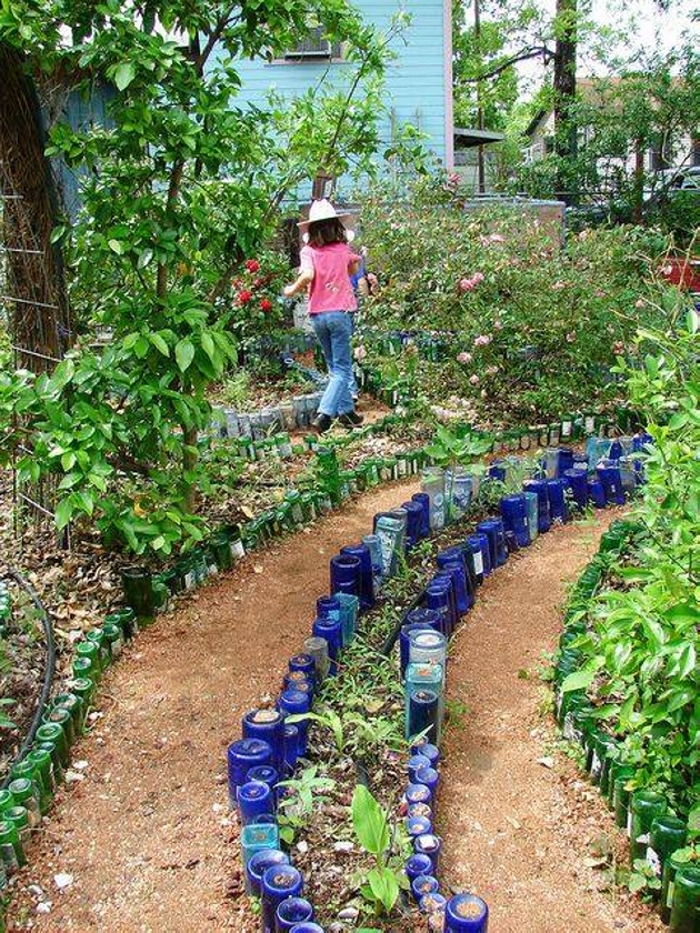 Garden ideas with used bottles upcycle art for How to use wine bottles in the garden