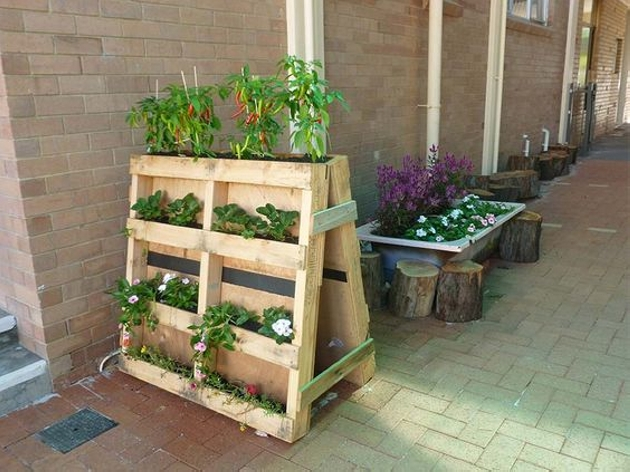 Upcycled wood pallet planters upcycle art for Making planters from pallets