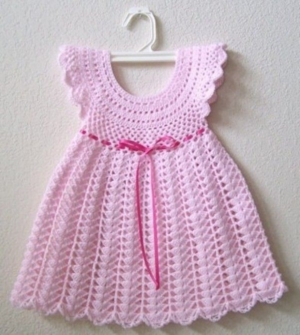 This crochet dress is a top choice for baby's first Christmas or Valentine's Day. Of course, that bright red color is also going to be the star of the show anytime that baby wears this dress. The pattern uses basic crochet stitches in combination with the crochet v-stitch for some extra detail.