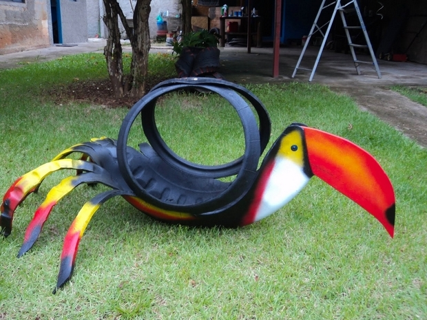 garden bird with used tires