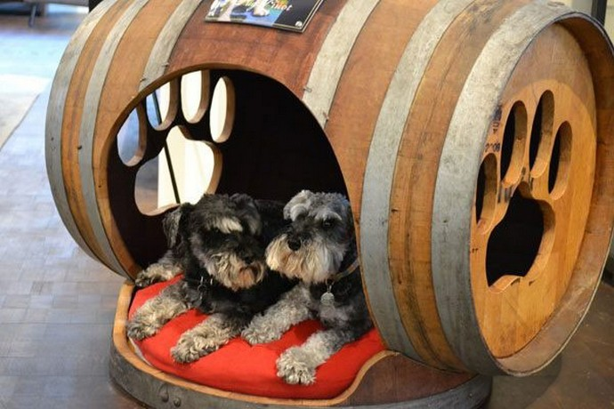dogs beds made with wooden barrels