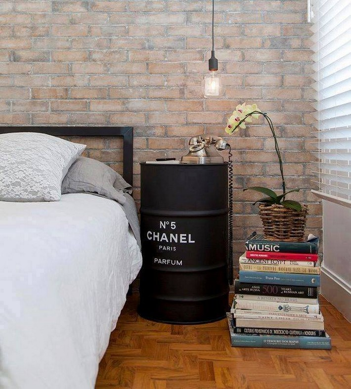 reused metal drum as bedside table