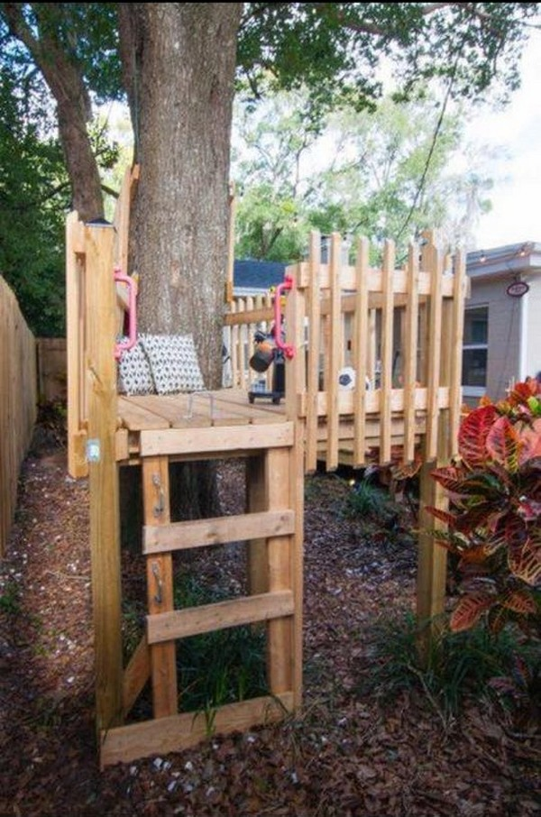 tree playhouse made with pallets